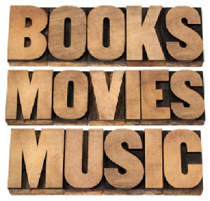 wooden blocks showing the words books, movies, music