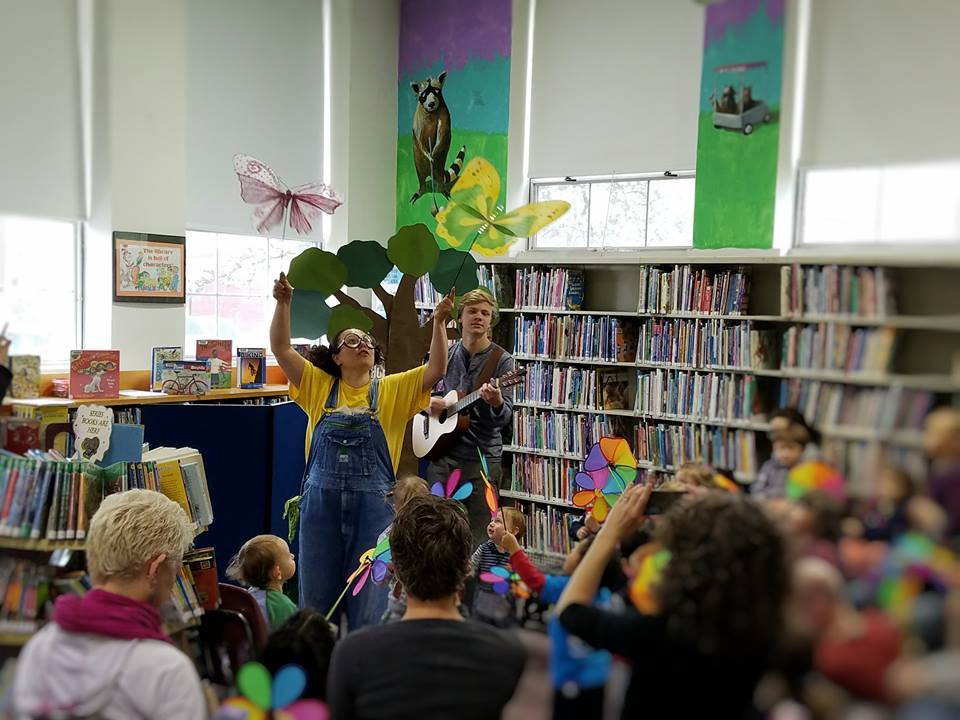 performers and audience at East Branch library