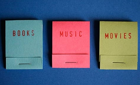 three matchbooks printed with the words books, movies, music