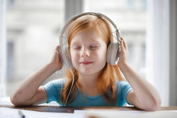 Photo of girl wearing headphones
