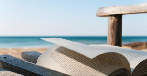 Chair at the Beach with a book on top.