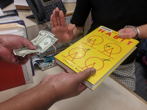 circulation staff refusing fine money