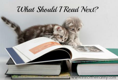 Kittens reading a book.