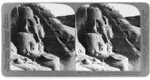 The sixty-five foot portrait statues of Ramses II, before rock hewn temple of Abu Simbel, Egypt